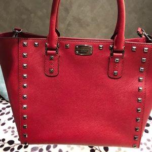Studded red MIchael Kors purse
